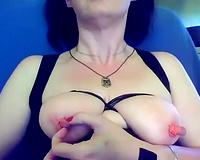 My slutty slutwife plays with her swollen teats on web camera