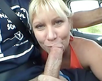 Blonde milf shows her fantastic dick-sucking skills to me in a car
