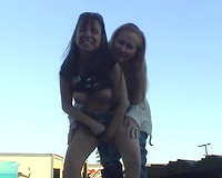 Two skanky older lesbian babes show off their goodies outdoors