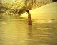 Sweet dark brown cutie rides her boyfriend on the beach