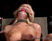 Gagged golden-haired gets her cute cunt whipped in BDSM scene