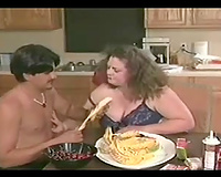 Dirty and breasty chubby slut seduces a chap in the kitchen