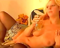 Hussy golden-haired bitch sucks vibrator and copulates her twat