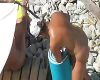 Spying on sexalicious woman sun bathing on a nudist beach