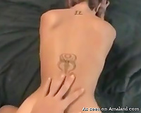 Sexy nympho with a worthwhile tattoo on her back gets screwed from behind