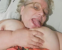 Chubby grey haired aged doxy was playing with her massive boobies