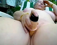 My slutty aged wife on the lounger dildoing herself