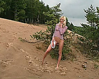 Marvelous and diminutive golden-haired cutie on the beach stripteases on web camera