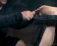Beautiful redhead BBC slut chained and drilled with a machine