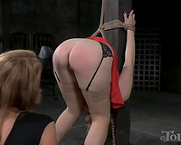 Blonde white slutty wife with large booty fastened to the post and bent over