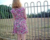 My seductive pale skin BBC slut walks around the street in her cute summer dress