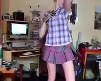 Skinny golden-haired teen disrobes and pleases herself with fingering