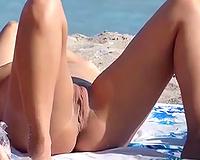 Spying on breathtaking dilettante slutwife masturbating on a nudist beach