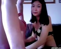 Titless Asian girlfriend sucks weenie standing on her knees