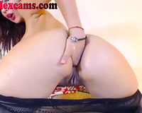 Hot web camera performer with large fake love muffins likes fisting and fingering her butt