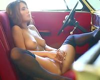 Fantastic beauty in nylon nylons masturbating passionately in a car