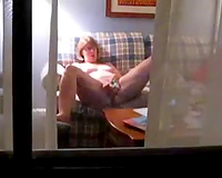 My older slutwife doesn't watch me in the window with a camera spying on her