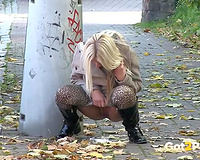 Hot European golden-haired chick on the sidewalk urinating
