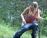 Hot golden-haired hot white wife shows her gorgeous shaved twat during the time that pissing in the forest