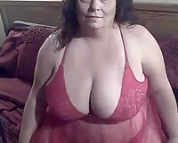 Chubby spunky brunette hair shows off her giant natural mounds