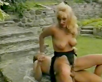 Fucking sexy golden-haired rides stiff penis outdoor