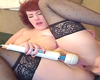 Red haired mamma enchanting her slit with large dildo