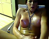 Brunette tgirl plays with her weenie in front of a cam
