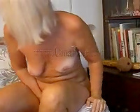 Granny pokes her old diminutive pussy with a sex-toy on cam