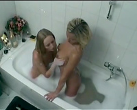 Pussy licking time with 2 cute taut golden-haired lesbies in bubble washroom