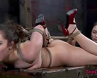 Lascivious blond nympho in red high heels is hogtied