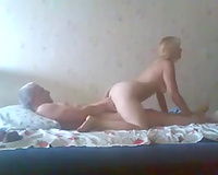 My cuckold ally was taping the way his golden-haired housewife was riding rigid pecker