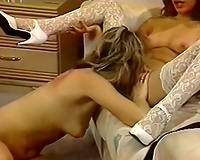 Two breathtaking classic white honeys on the daybed pleasuring every other