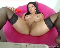 Spreading legs apart slutty breasty chick in nylons begins masturbating