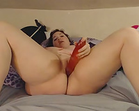 My huge-assed wife entertains herself by toying her vagina