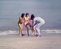 Awesome group sex on the beach with slim and lascivious golden-haired women