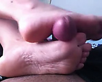 My paramour shows her pedicured feet to me and gives me a footjob