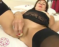 This perverted aged black cock slut at no time acquires tired of using her sex toys