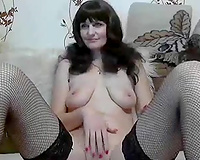 Awesome brunette hair web camera nympho in fishnet nylons masturbated a bit