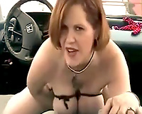 Red haired MILF with large love melons squeezes and pins her bumpers
