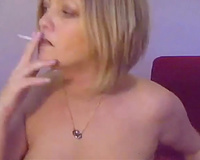 Elegant golden-haired mom smokes skinny cigarette