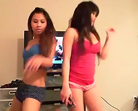 Two charming and juvenile Asian chicks dancing in their pants