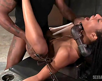 Black sexy white bitch restrained with metal tubes and boned by 2 chaps