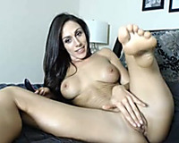 Appealing housewife masturbating with sex toy in non-professional session