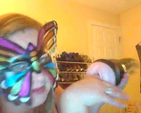 Wearing butterfly mask blonde haired cam whore was playing with a toy
