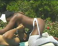 Curvaceous ebon nurse sucks fat BBC in 69 position over the pool