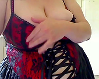 big beautiful woman aged granny posing on web camera in perverted corset