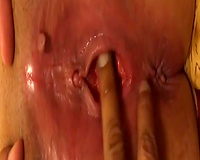 Close-up vid of soaking pink inviting vagina being fingerfucked a bit