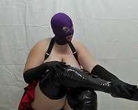 Chubby masked wench nude her actually massive saggy boobies during the time that sitting