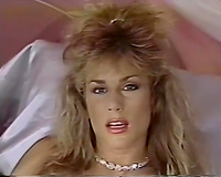 Sweet blonde classic playgirl alone in her bedroom watching porn