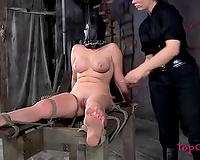 Helpless serf cant watch everything coz of that leather mask